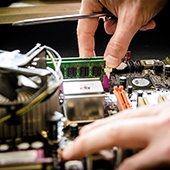 hands repairing a computer