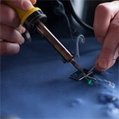 person soldering