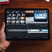 person editing video on a tablet