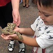 kid holsing a snake