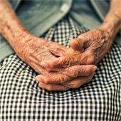 elderly woman holding hands