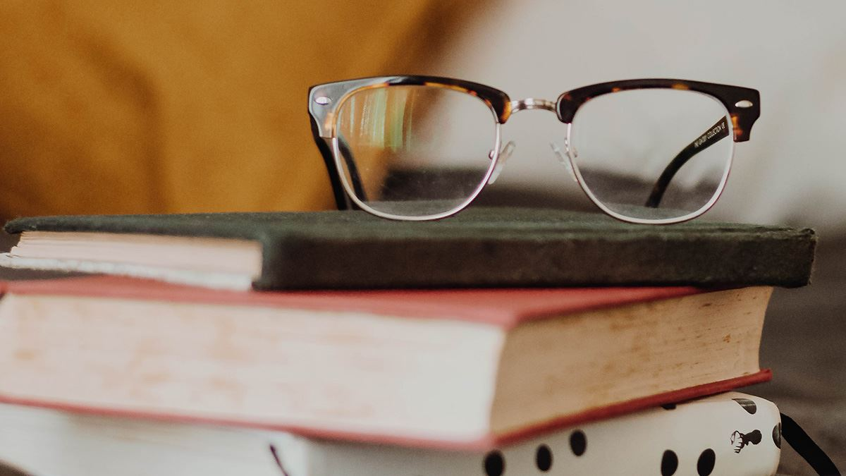 glasses and stack of books