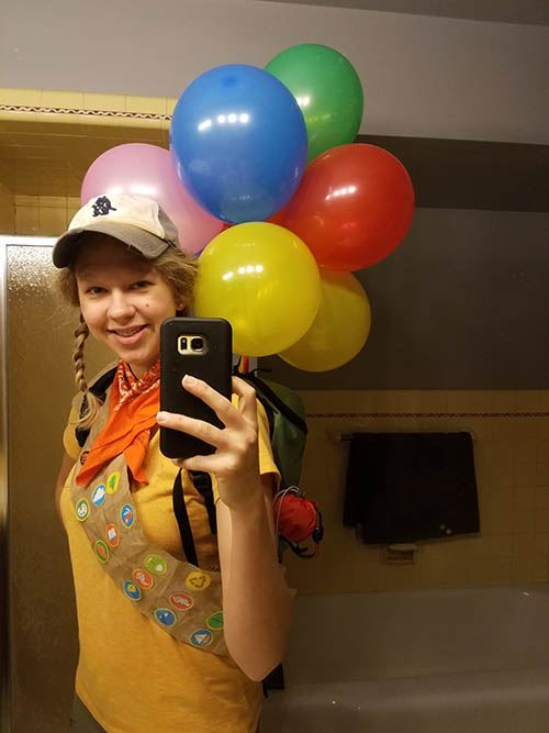 Librarian dressed as Russell from the movie Up