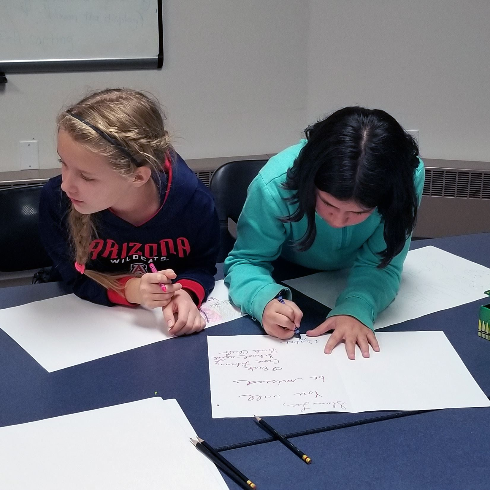 Photo of kids doing an activity at book club.